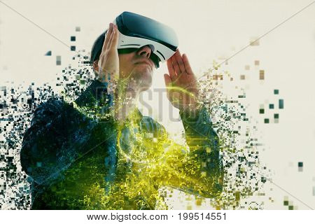 The man with glasses of virtual reality. Future technology concept. Modern imaging technology. Fragmented by pixels.