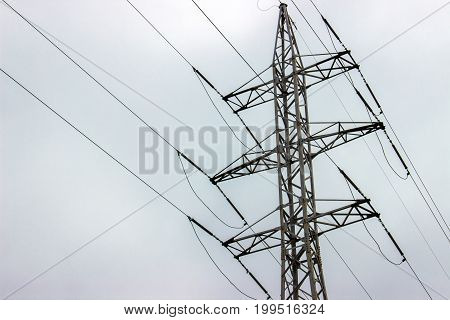 high voltage electrical towers in line. sky background