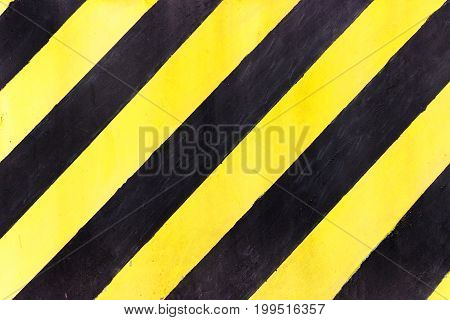 Safety stripes on construction site Black and yellow Under construction sign over a grunge texture top view