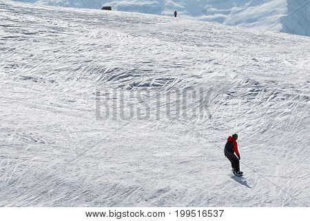 Snowboarder And Skier Downhill On Snow Off-piste Slope