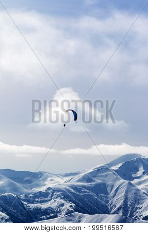 Sky Gliding In Winter Snow Mountains