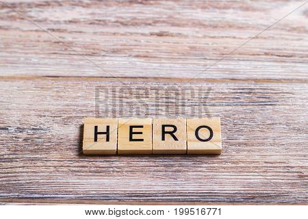 word hero written on cubes on wooden background