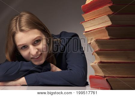 Cute happy successful female student with books (Knowledge training education self development concept)