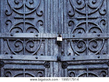 Closed. No way out. Metal medieval vintage door background