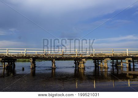 Temporary wooden bridge across the river side photo