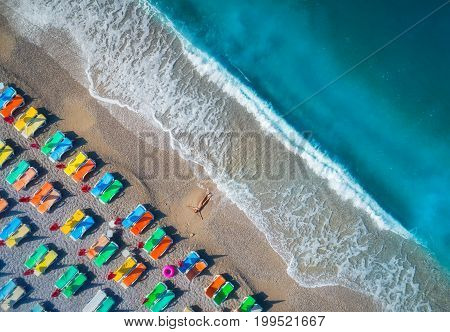 Aerial View Of Lying Woman On The Beach