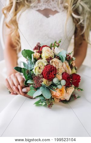 Bride Holds A Bunch Of Flowers. Beautiful Bridal Bouquet With White And Peach Roses, Red Peonies, An