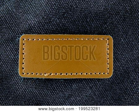 The label on old black leather background