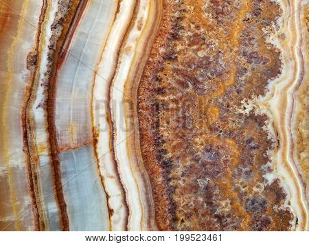 close up of polished marble stone with abstract pattern