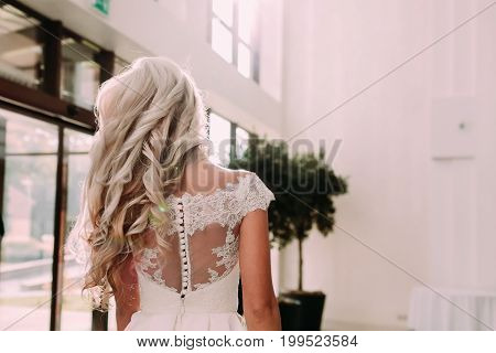 Close-up Image Of Back Of Elegant Blonde With Long Curly Hair And Luxury Wedding Dress. Bride's Morn