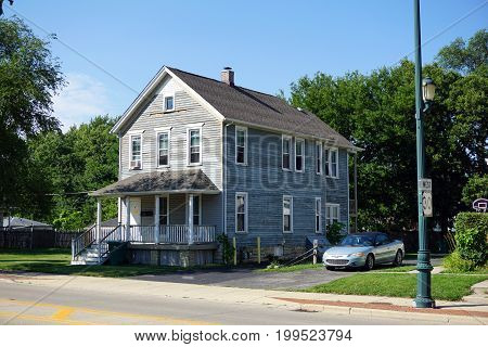 JOLIET, ILLINOIS / UNITED STATES - JULY 18, 2017: A two story single family home, with a front porch, on Plainfield Road in Joliet.