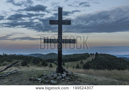 Sunrise on Velky Javonik hill in summer Slovakia morning with big cross