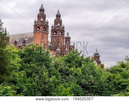 Towers of Kelvingrove Gallery and Museum in Glasgow Scotland along the Kelvin River.