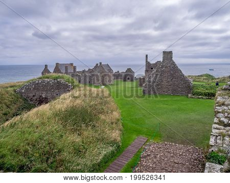 STONEHAVEN, SCOTLAND: JULY 24: The ruins of Dunnottar Castle on July 24, 2017 at Stonehaven, Scotland. Stonehaven is located in Aberdeenshire Scotland.