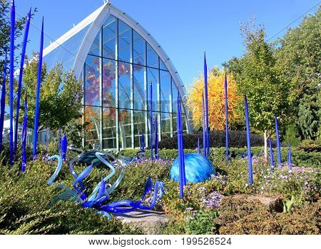 Seattle July 29 2017: Blown glass in abstract shapes in blue and yellow Chihuly Garden and Glass Museum Seattle Washingtonusa