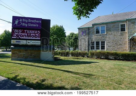 JOLIET, ILLINOIS / UNITED STATES - JULY 18, 2017: The Big Brothers and Big Sisters of Will and Grundy Counties express big thanks, on the sign in front of the organization's building, to Exxon Mobil.