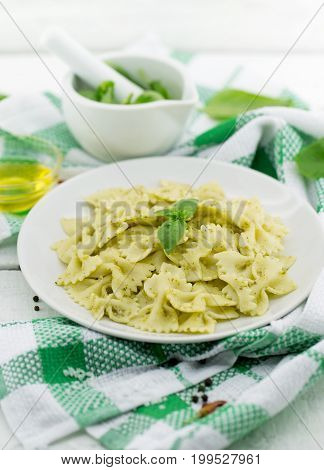 Farfalle Pasta With Pesto Genovese (basil Sauce) On White Rustic Wooden Table. Italian Cuisine