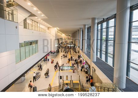 TOKYO, JAPAN - JUNE 18 2017 : passenger walking in arrivals terminal 1 at narita international airport