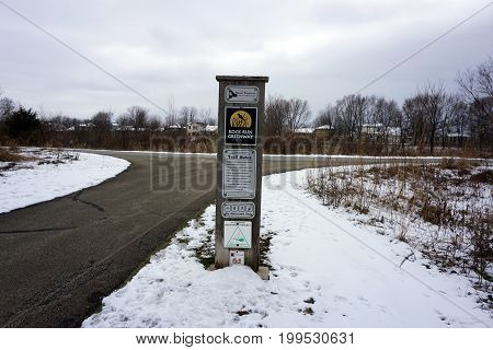 JOLIET, ILLINOIS / UNITED STATES - JANUARY 3, 2016: A posted sign lists the trail rules for the Rock Run Greenway Trail.