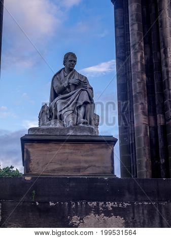 EDINBURGH, SCOTLAND - JULY 30: Statue of Sr Walter Scott at the base of the Scott Monument at night on July 30, 2017 in Edinburgh Scotland. Scott is Scotland's most famous writer.