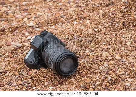 Dslr Camera On Stone Beach Wet From Water Sea Wave