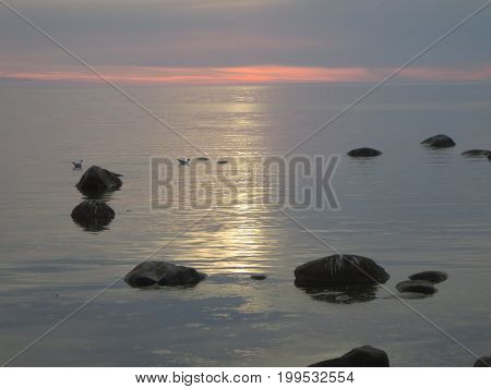 Peaceful evening at the Baltic sea when the sun goes down