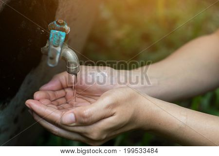 Women use hand the water frame to drink Water shortage concept.
