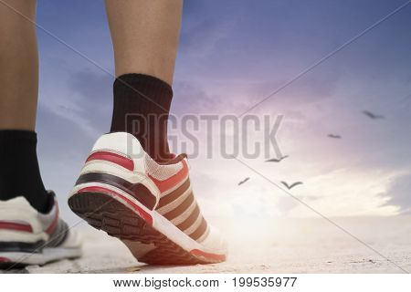 sport man walking to goal concept as run to success belive and faith of life can be winner- can used for business background as commitment and attempt