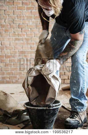 Handyman prepare cement use for construction