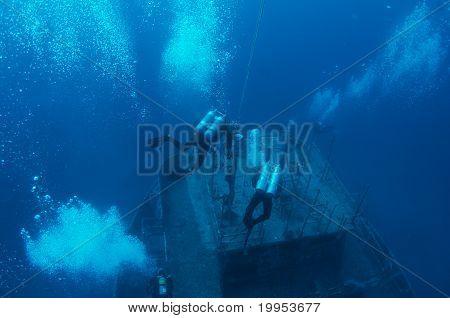 Scuba Divers on a Wreck