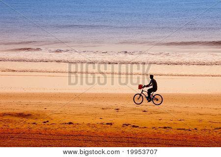 Man Riding Bicycle On Atlantic Beach, Ponte Vedra, Florida