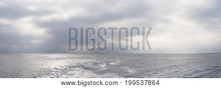 Panorama of Godrays and morning view of ocean from boat at Pelican Bay on Santa Cruz Island Channel Islands.