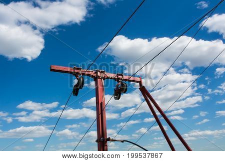 Red ropeway cablecaar construction against blue sky and beautiful white clouds Moscow Russia.