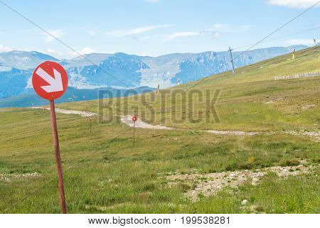 Ski Trails At Carpatian Mountains On Autumn Day, Red Signs With Arrows, Bucegi Natural Park, Romania