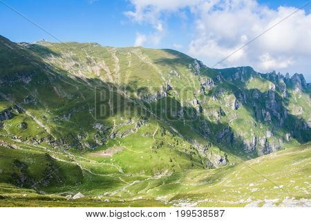 Panoramic View Over The Carpatian Mountains, Green Valleys And Beautiful Blue Sky At The Background,
