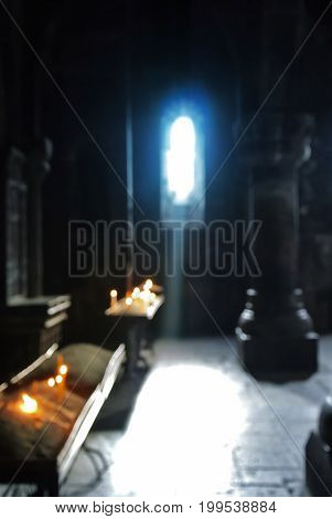 Blurred Background Of Old Armenian Christian Church Monastery Interior With A Sun Ray Falling To The