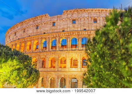 Beautiful Landscape Of The Colosseum In Rome- One Of Wonders Of The World  In The Evening Time.
