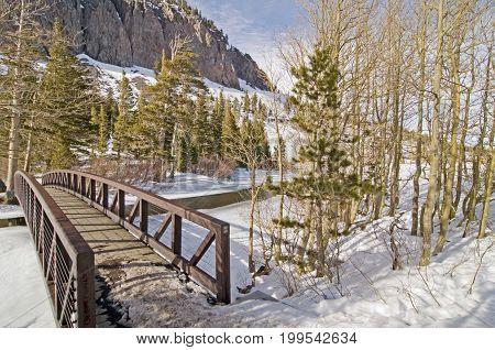 View of bridge and frozen Twin Lake in Tamarack Mammoth Lakes, CA.