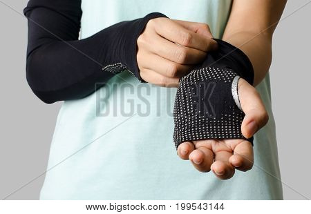 The woman wearing bicycle armbands for cycling in sunny day