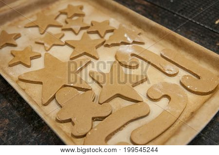 Ready-to-bake holiday gingerbread cookies on baking pan