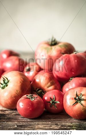 ripe Tomatoes on wooden background , concept farm vegetables and healthy eating