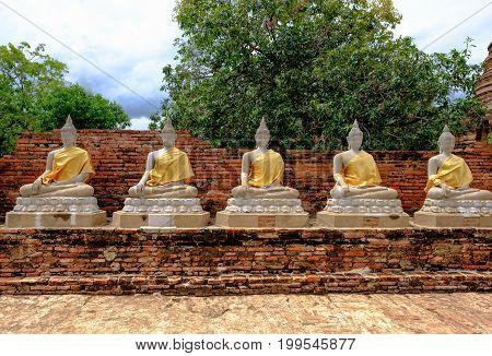 Selective Focus Image Of Ancient Row Buddha Statue In Wat Yai Chai Mongkol Temple. Ayutthaya Histori
