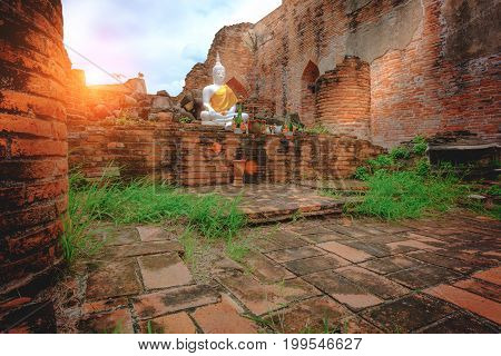 Outdoor White Buddha Statue In The Old Church With  Red Brick Wall At Wat Kudi Dao In Ayutthaya Hist