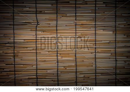 Selective focus on bamboo weave texture pattern background.
