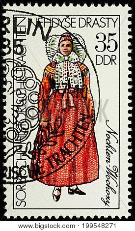 Moscow Russia - August 13 2017: A stamp printed in GDR (East Germany) shows woman in traditional costume of Nochten series
