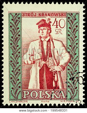 Moscow Russia - August 12 2017: A stamp printed in Poland shows man in Polish traditional costume Cracow region series