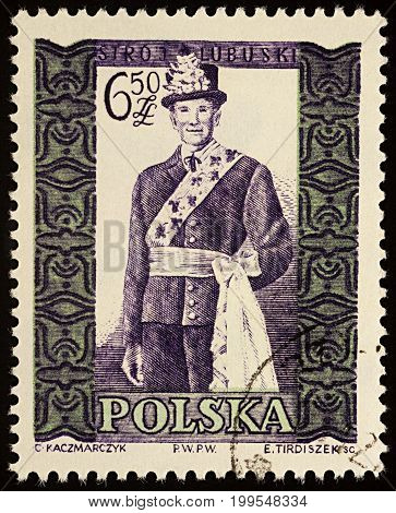 Moscow Russia - August 12 2017: A stamp printed in Poland shows man in Polish traditional costume Lubuskie region series