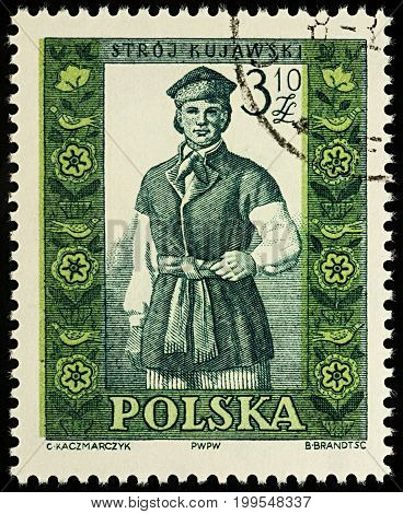 Moscow Russia - August 12 2017: A stamp printed in Poland shows man in Polish traditional costume Kujawy region series