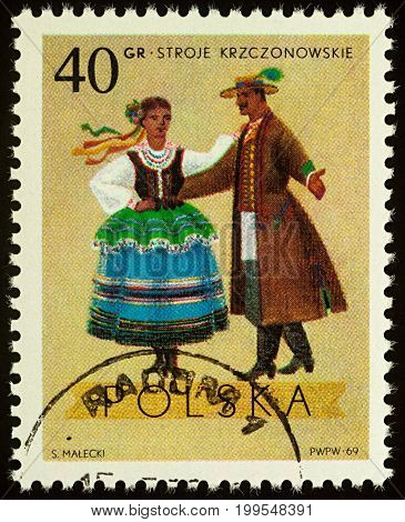 Moscow Russia - August 11 2017: A stamp printed in Poland shows dancing couple in traditional costumes from Krczonow Lublin series