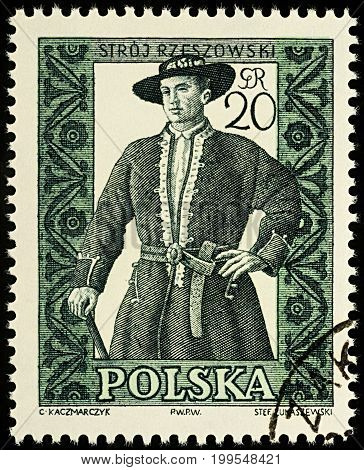 Moscow Russia - August 12 2017: A stamp printed in Poland shows man in Polish traditional costume Rzeszow region series